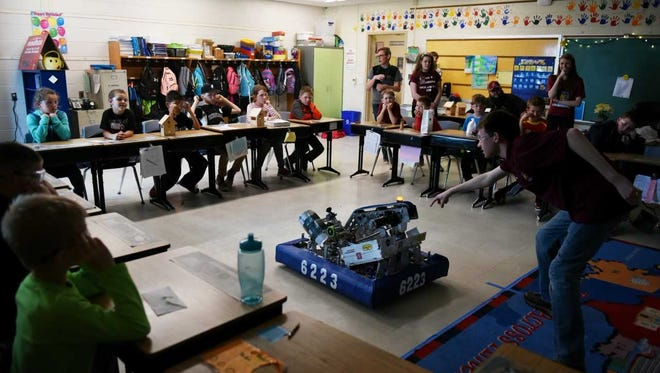 Arsenal Engineering Team 6223 shows off last year's robot to a group of students at Valley View Elementary School.