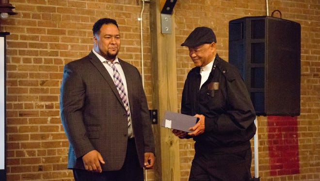 "Zydeco musician Keith Frank, left, presents an award to Robby ""Mann"" Robinson of Zydeco Force at the second Creole Renaissance Gala."