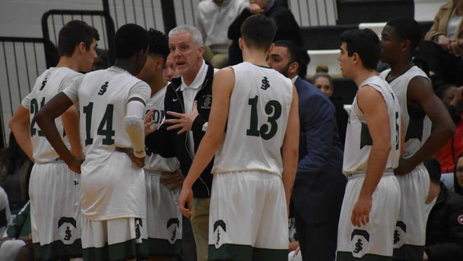 Rookie head coach Mike Thompson talks to his St. Joseph players during a home game this season.