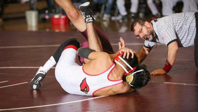 Plainfield's Walter Pineda wrestles against North Plainfield.
