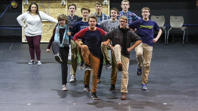 """Senior Bryce Kalaus (center) leads the cast in """"Brotherhood of Man"""" during a rehearsal for St. Mary Catholic High School's upcoming production of """"How to Succeed in Business Without Really Trying."""""""
