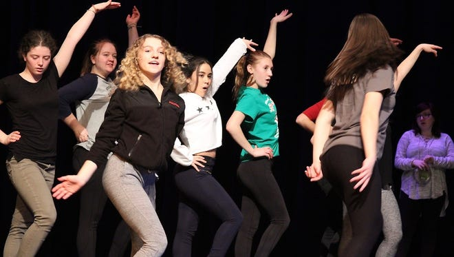 Kady Rassmussen, Elyse Roush, Michelle Quesada and Alyssa Chechak (in green) in a scene from Bullets Over Broadway.
