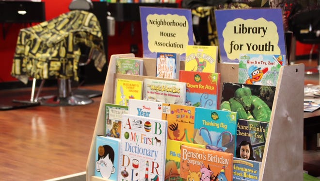 """Plainfield Public Schools Office of Early Childhood has launched a new initiative - """"Books, Barbers and Dads"""" designed to increase father engagement, as well as improve early literacy development, by creating child-friendly reading spaces at the local barbershops in the city."""