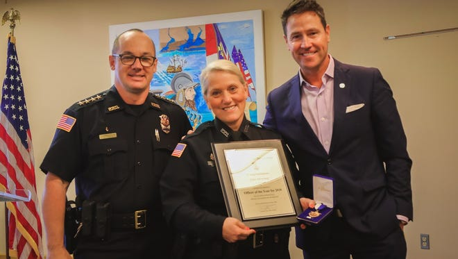 From left, Pensacola Police Department Chief Tommi Lyter, PPD Detective Lisa Alverson and Mayor Ashton Hayward stand for a photo Thursday, April 19, 2018, after an award ceremony at Pensacola City Hall. Alverson was named as the PPD Officer of the Year for 2018.