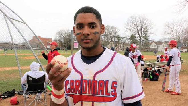 Plainfield senior Waldy Arias poses after getting his 100th career hit on April 9.