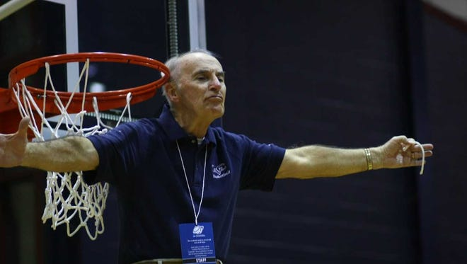 Jimmy Unger plays to the crowd while helping cut down the Nets after the LVC women's basketball team advanced to the NCAA Sweet 16 back in 2011.