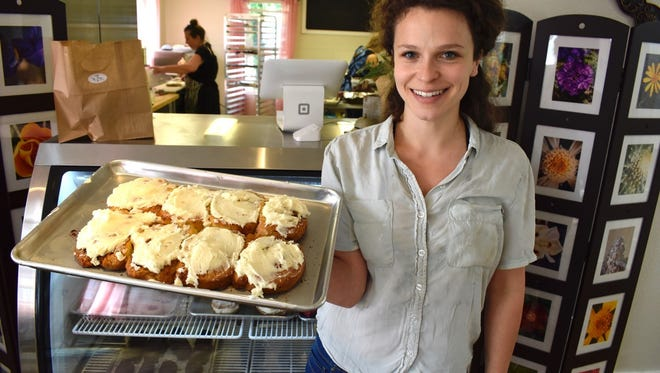 Zoie Claire's  Kea Angel, baker at Zoie Claire's Bakery and Bistro, with popular cinnamon rolls.
