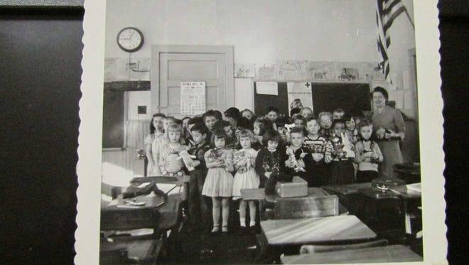 Children in West Milford's rural Echo Lake School grades kindergarten through 3 are seen with teacher, Verina Mathews Genader, in 1950.