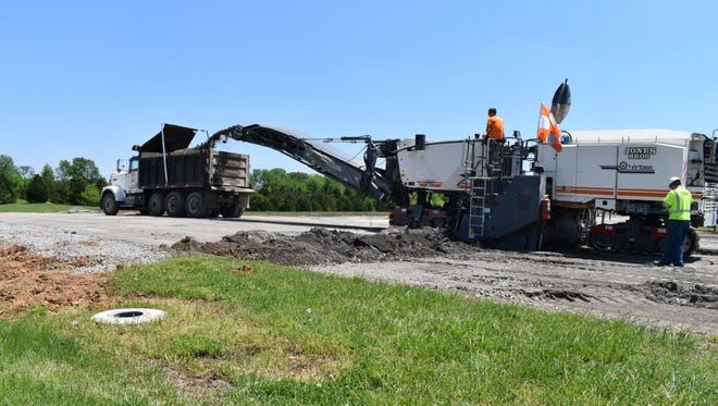 The $12.9 million runway reconstruction project at Clarksville Regional Airport began in early May with the complete milling and resurfacing of the airport's primary 6,000-foot runway.