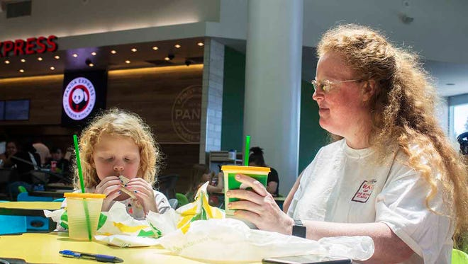 Thea Wickelgren eats lunch with her mom, Emily Wickelgren, at the Arden Fair Mall in Sacramento.