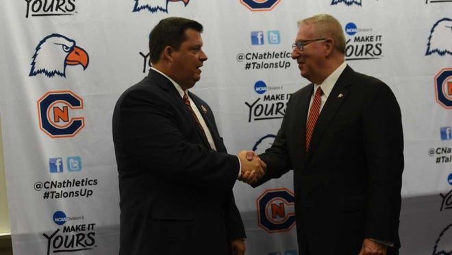 Carson-Newman athletic director Matt Pope is congratulated by University President Randall O'Brien after being introduced in Jefferson City on July 9, 2018.