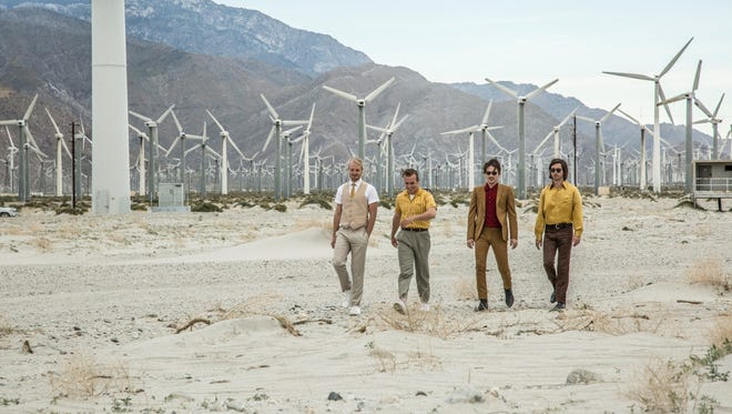 """Members of The Shelters walk in the desert near Palm Springs during the shooting of their video """"Gold."""""""