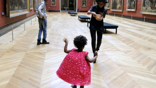 Beyonce, Jay Z and Blue Ivy visit the Louvre in Paris.