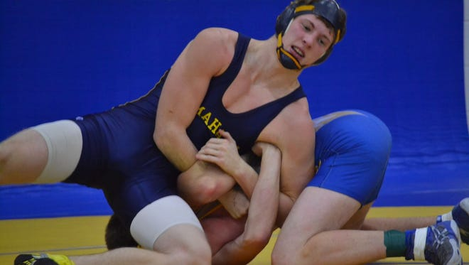 Tomahawk's Nate Flohr wrestles against Oconto's Ben Giesler in a second-round match at the Oconto Tournament on Saturday in Oconto.