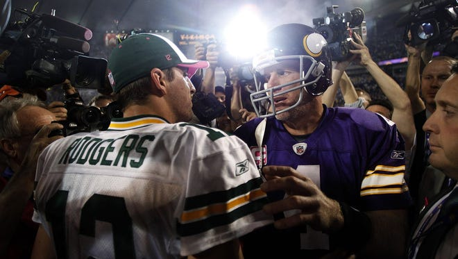 Minnesota Vikings quarterback Brett Favre (4) and Green Bay Packers quarterback Aaron Rodgers meet after the Vikings beat the Packers 30-23 in an NFL football game Monday, Oct. 5, 2009, in Minneapolis.