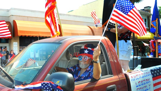 Ed Milnor was red, white and blue driving the truck for the American Legion Post 117. People lined the streets in downtown Melbourne, many of them in red, white and blue. for the Melbourne Independence Day Parade.