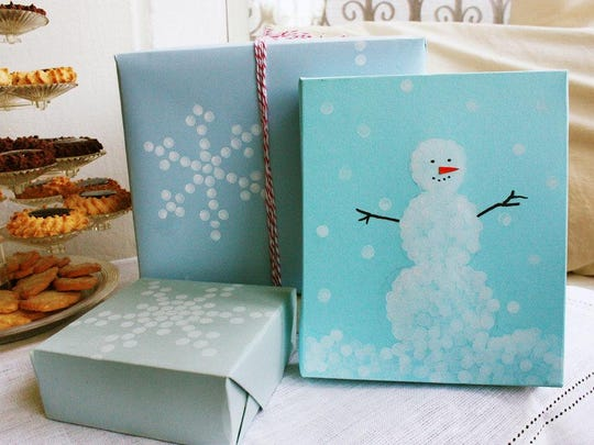Create a unique gift topper with a pencil eraser dipped in acrylic paint as seen on the snowman gift wrap.