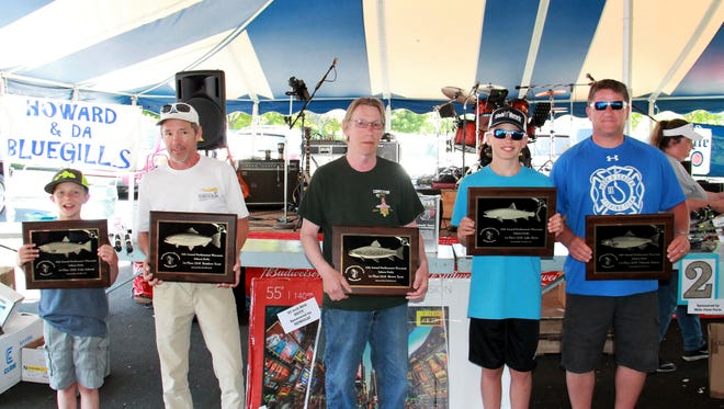2018 Manitowoc Salmon Derby winners, from left: Joshua Velleskey, Tony Castle, Kevin Groh, Cooper Kneser and Ken Benter.