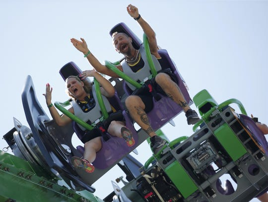 Guests ride The Joker, the latest roller coaster at