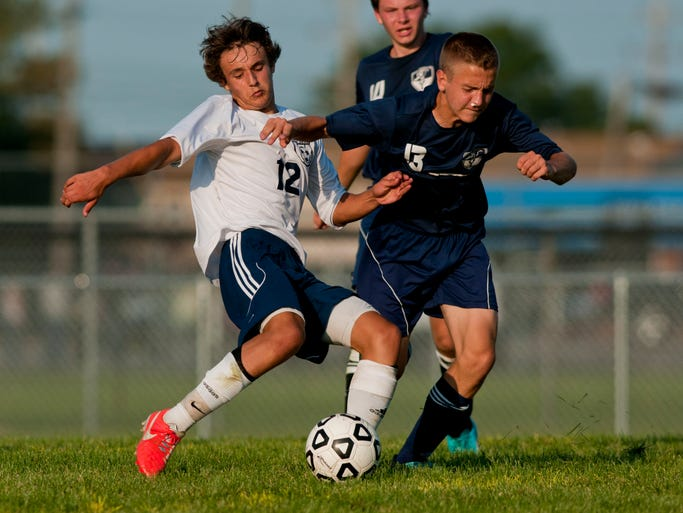 Richmond sophomore Brendon Jacques attacks the goal in front of Yale sophomore Ryan Rutkofske during a soccer game September 3, 2014 at Richmond High School.