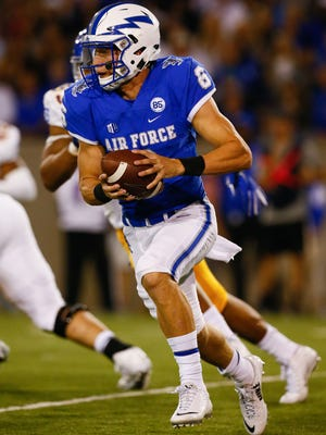 Air Force Falcons quarterback Nate Romine (6) runs the ball in the first quarter against the San Jose State Spartans at Falcon Stadium.