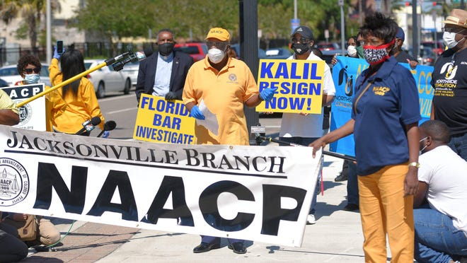 Isaiah Rumlin, president of the Jacksonville Branch of the NAACP, pictured here during a protest outside the Duval County Courthouse in May, sent a letter this week to city leaders urging rejection of a proposed Lot J development deal that would have up to $233 million in city investments and incentives. Rumlin said the city must direct spending to help neighborhoods struggling with poverty and crime.