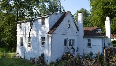 The high bid was $1,000 for the single-family home on 1.7 acres at 55 Cortlandt Ave. in the town's July 15 foreclosure sale.