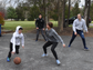 Patrick Siegrist tries to dribble around his sister,