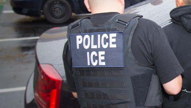 File art of ICE agents making arrest