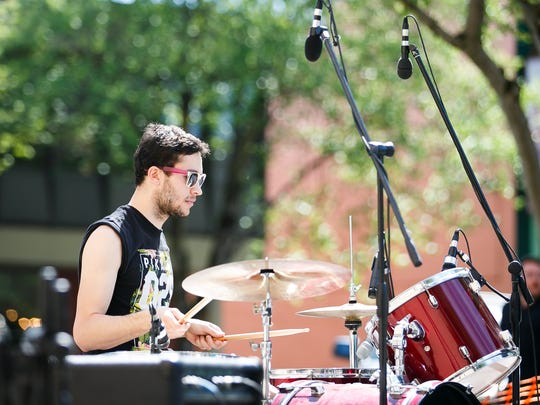 Jake Glazer plays the drums as Doggy Dog World performs at Make Music Day in Downtown Salem on June 21, 2017.