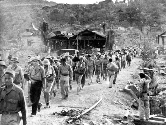 In this 1942 file photo, American and Filipino prisoners of war captured by the Japanese are shown at the start of the Death March after the surrender of Bataan on April 9 near Mariveles in the Philippines, during World War II. Hundreds of American soldiers and thousands of Filipinos died along the way.