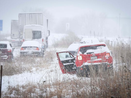 Officials work on cleaning up a 70-vehicle pileup on  Interstate Highway 35 southbound Monday, Feb. 5, 2018, in Ames.