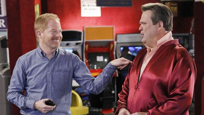 "Jesse Tyler Ferguson (left), who plays Mitchell Pritchett in the ABC sitcom ""Modern Family,"" is shown interacting with his husband Cameron on the show, played by Eric Stonestreet."
