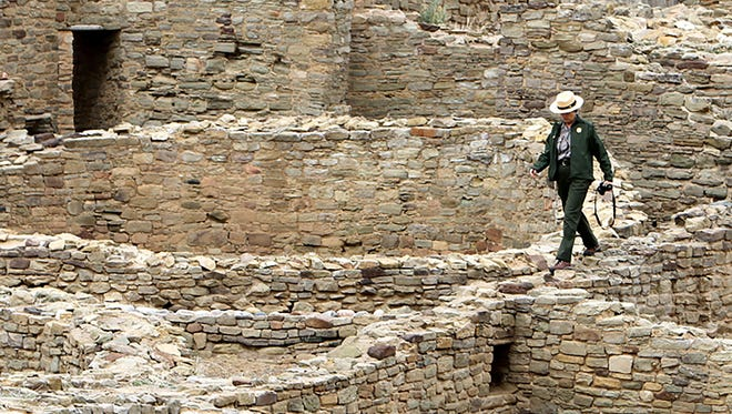 A ranger walks the Aztec Ruins National Monument site in this Daily Times file photo.