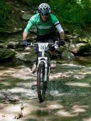 Doug McClintock, president of the Cincinnati Off-Road Alliance, rides at East Fork State Park.