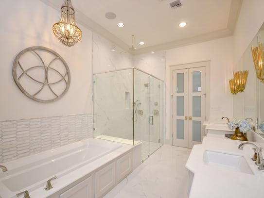 The master bath is a luxurious oasis for relaxing.