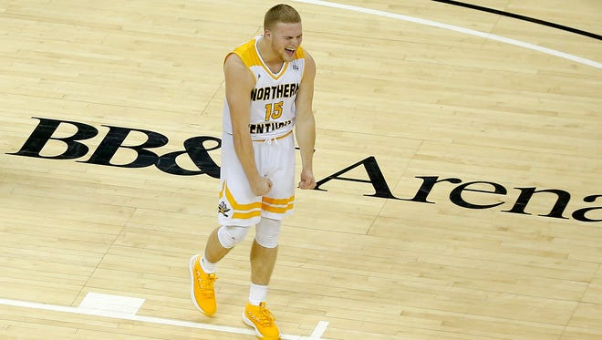 Northern Kentucky Norse guard Tyler Sharpe (15) celebrates as time expires in the second half of the NCAA Horizon League basketball game between the Northern Kentucky Norse and the Green Bay Phoenix at BB&T Arena in Highland Heights, Ky., on Saturday, Feb. 10, 2018. The Norse took an 86-80 win over Green Bay.