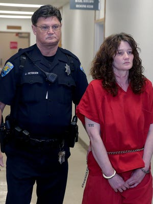 Amber Lynn James is escorted to her arraignment on a charge of second degree murder on Wednesday in Kitsap County Superior Court. James is accused of killing her 9-year-old son.