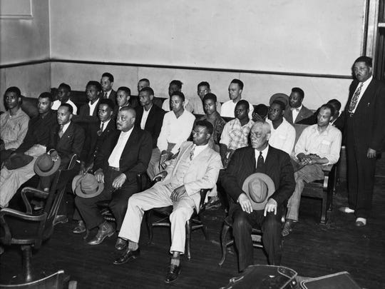 Twenty-five black men sit in Maury Circuit Court on