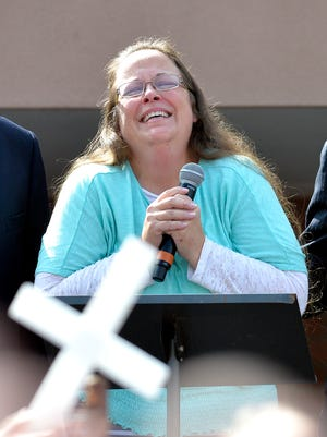 In this file photo dated Tuesday, Sept. 8, 2015, Rowan County Clerk Kim Davis pauses as she speaks after being released from a detention center, Tuesday, Sept. 8, 2015, in Grayson, Ky.
