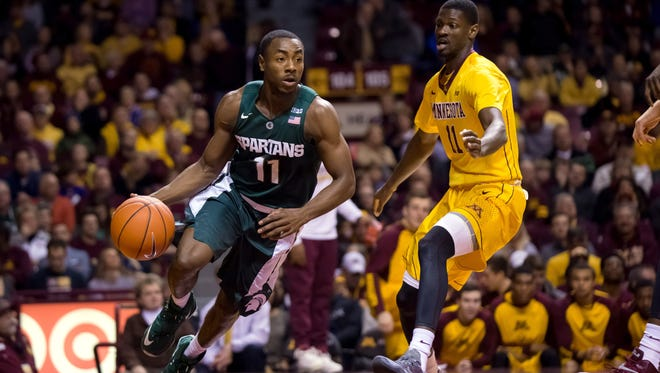 Michigan State Spartans guard Lourawls Nairn Jr. (11) dribbles in the first half against the Minnesota Gophers guard Carlos Morris (11) at Williams Arena.
