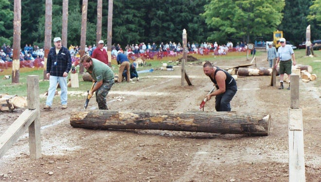 Lumberjacks compete in the logrolling contest at the Woodmen Show.