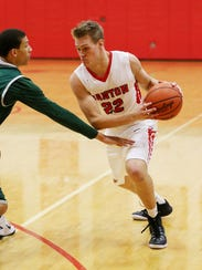 Canton senior guard Greg Williams goes to work against