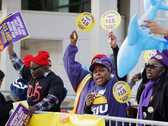 SEIU Local 1 union members protest for an increase