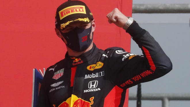 Red Bull driver Max Verstappen celebrates after winning the 70th Anniversary Formula One Grand Prix at the Silverstone circuit Sunday in Silverstone, Englan.