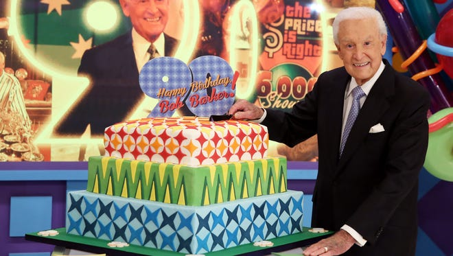 """Bob Barker poses for a photo on the set of """"The Price is Right"""" after a special appearance that will celebrate his 90th birthday at CBS Studios, in Los Angeles on Nov. 5, 2013."""