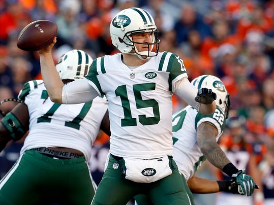 FILE - In this Dec. 10, 2017, file photo, New York Jets quarterback Josh McCown (15) throws against the Denver Broncos during the first half of an NFL football game Denver. The Jets and quarterback McCown have agreed on a one-year deal, McCown's agent Mike McCartney announced Tuesday, March 13, 2018, on Twitter.  (AP Photo/Joe Mahoney, File)