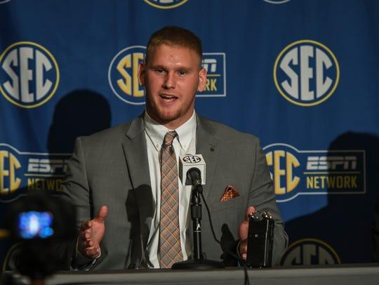Auburn offensive lineman Braden Smith talks to reporters