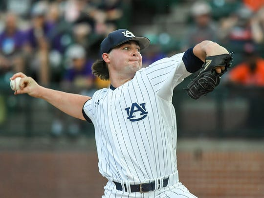 Auburn pitcher Tanner Burns gets the win while throwing