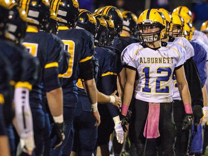 Iowa City Regina shakes hands with  Alburnett after